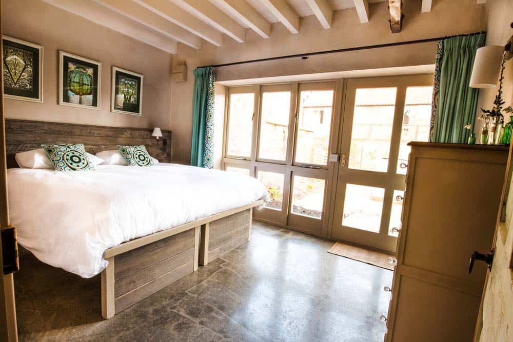 double bedroom turquoise pillows norfolk yoga retreat