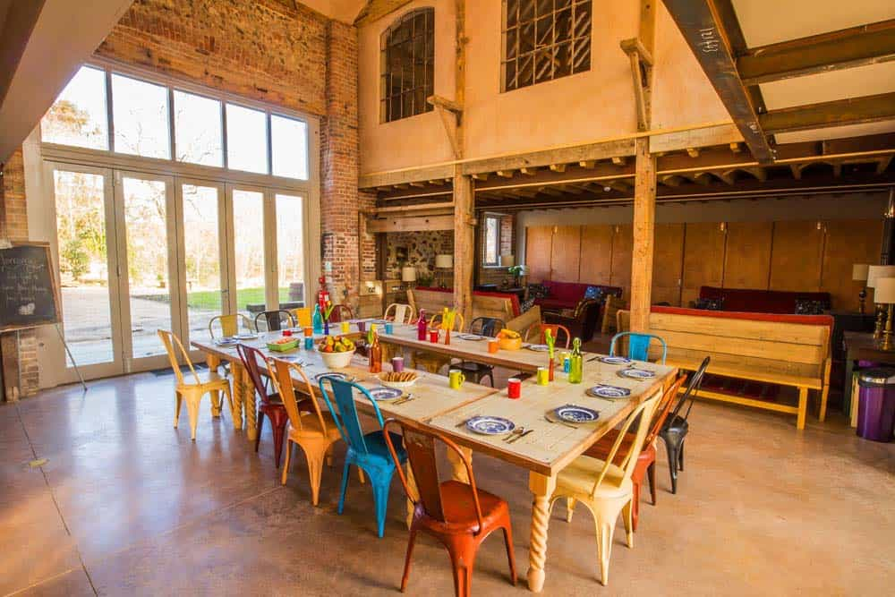 dining area colourful chairs large table norfolk yoga retreat