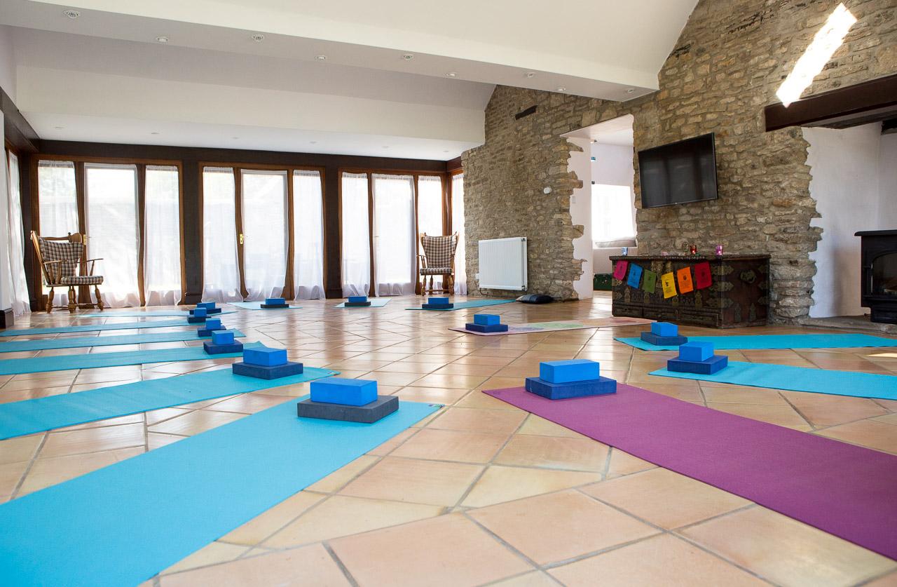 yoga space facing long windows mats on floor thrupp
