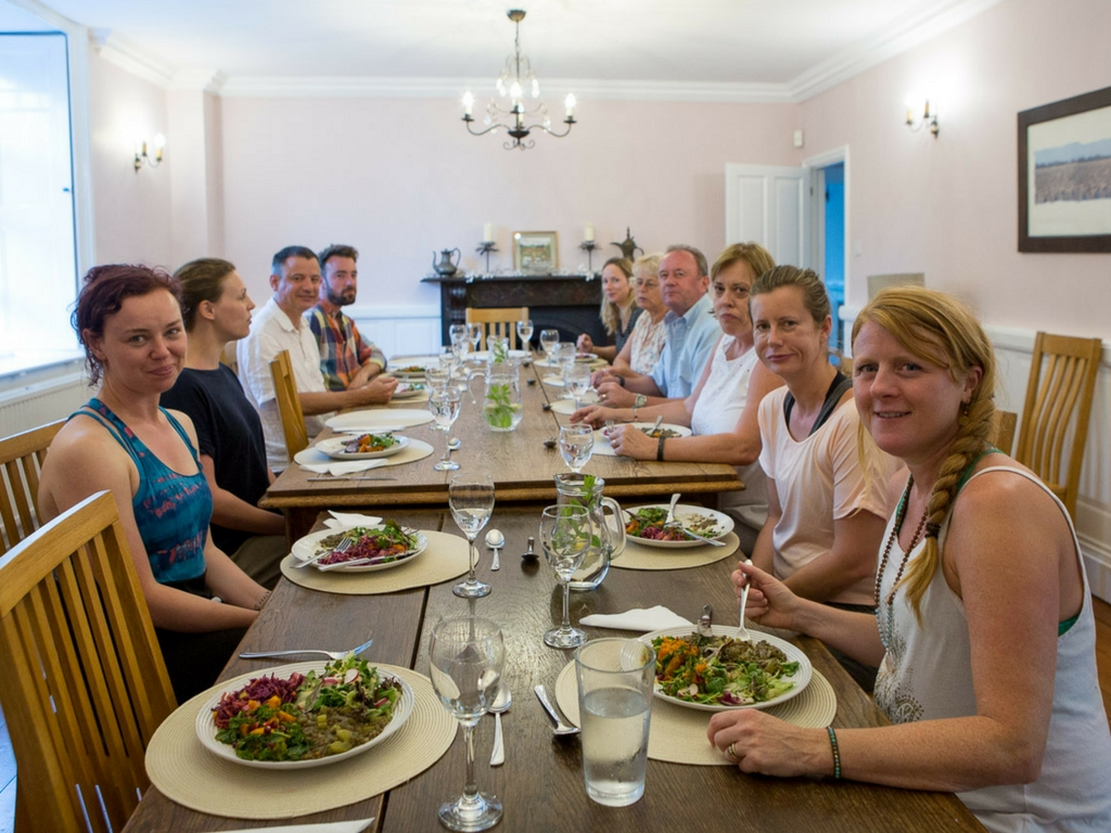 people siting around dining room with food thrupp oxfordhshire