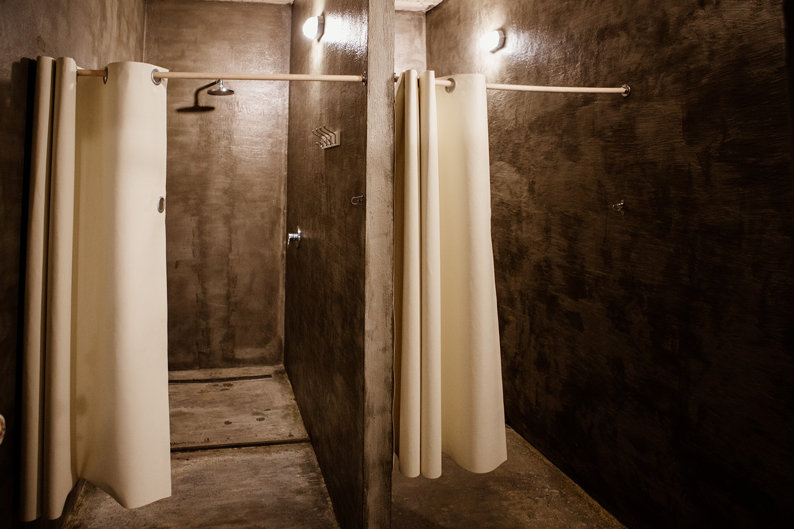 two showers polished concrete grey two white shower curtains - hiking yoga holiday montenegro