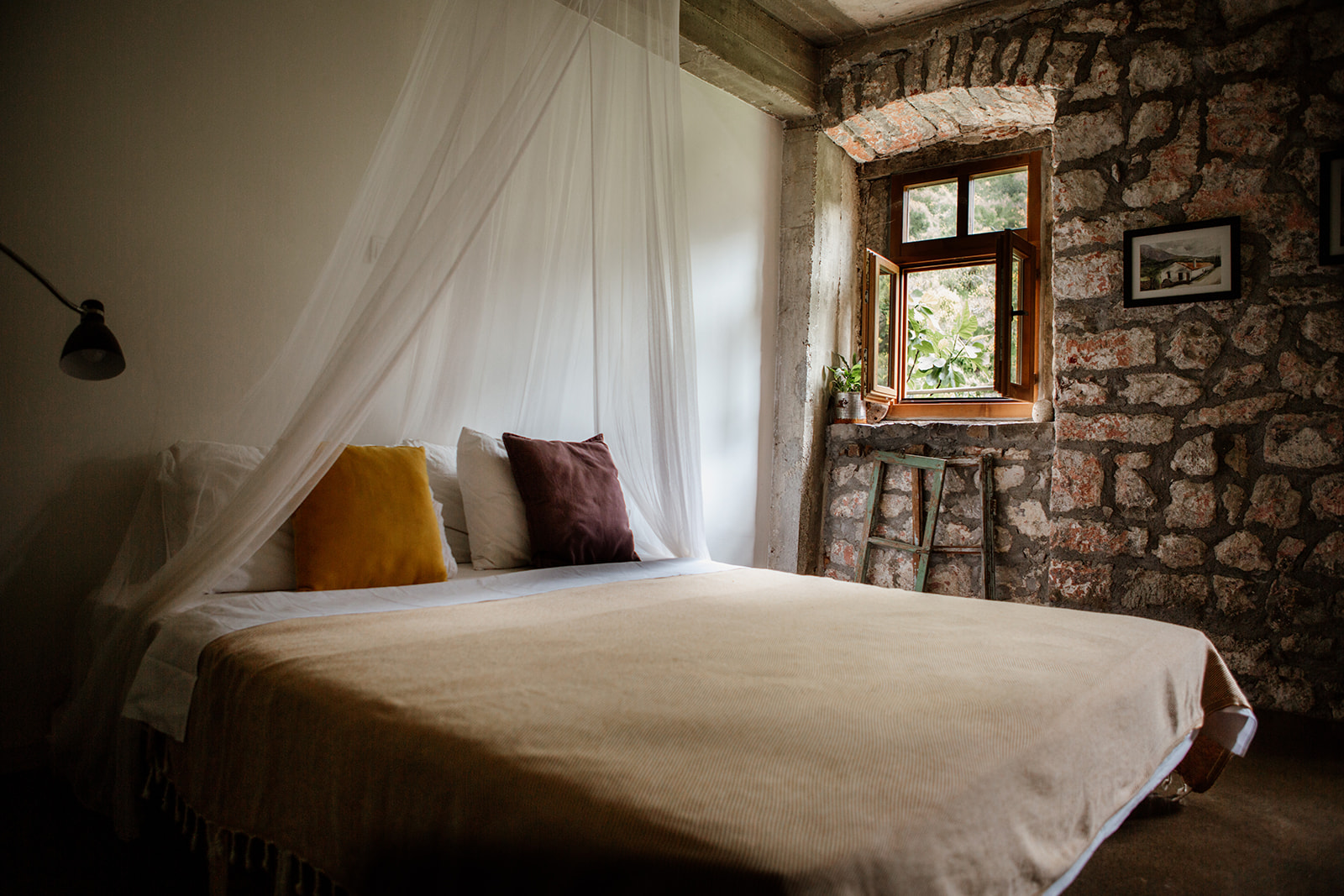 double bed stone wall and window yoga holiday montenegro