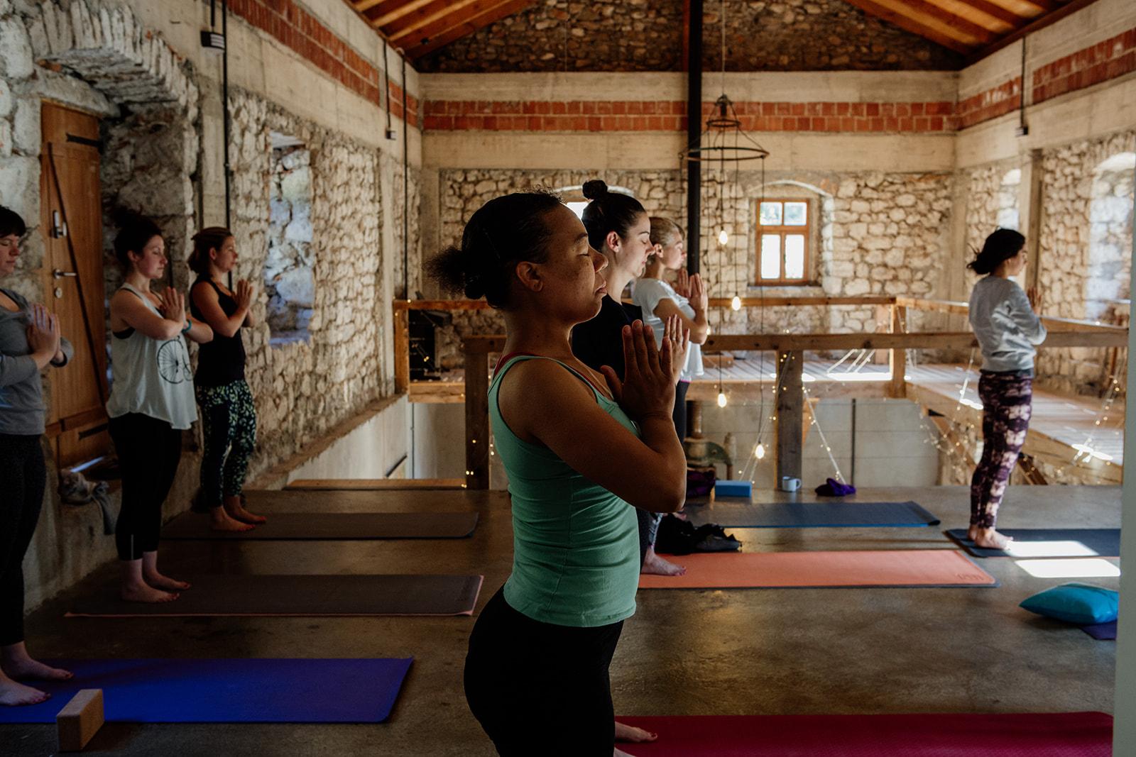 tadasana hands in prayer in yoga space - yoga holiday montenegro