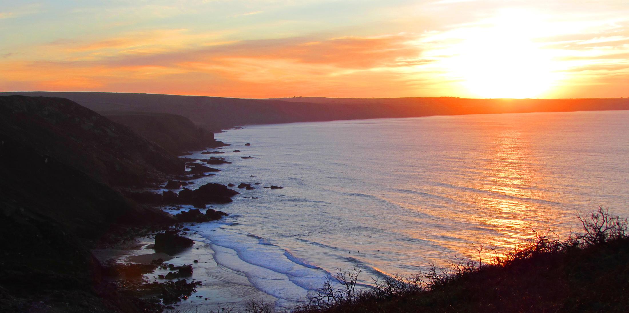 sunset over sea cornwall
