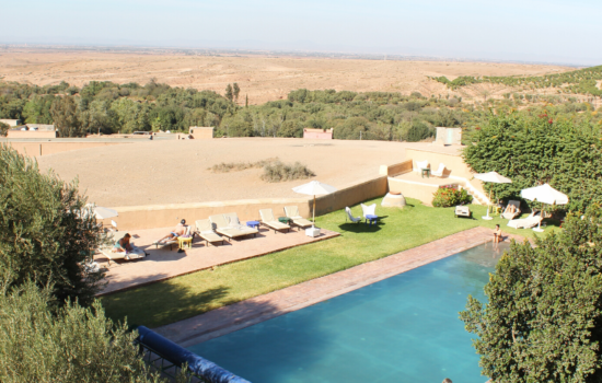 heated outdoor pool and lounge area yoga holiday Marrakech
