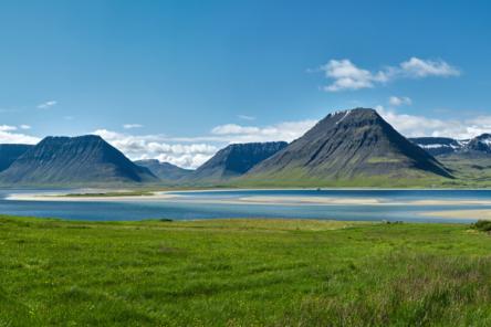 Iceland summer landscape mountains, lake, houses